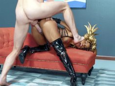 Demi Sutra in black boots gets fucked from behind