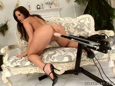 Dildo machine fucks busty Angie Knight on the couch