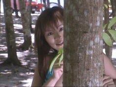Cute and bosomy Japanese lady Yoko Matsugane walks in woods