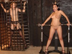 Small-titted babe in BDSM cage challenged with big hard cock