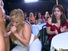 Handsome stripper entertains a huge crowd of horny girls dancing naked in a club