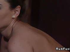 Lesbian customer fingering masseuse to orgasm