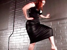 Bad ass dominatrix stepping on hard cock
